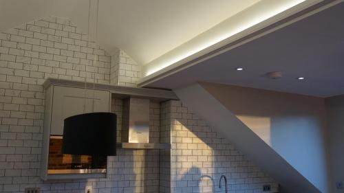 loft conversion with steel light feature