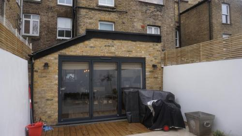 rear extension with bi folds hammermith